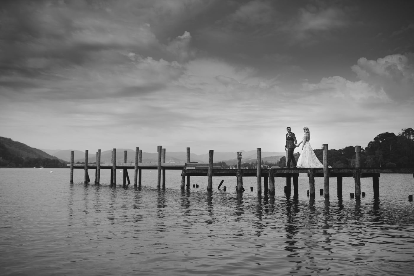 Bride and Groom Walking Down the Jetty at Storrs Hall Wedding