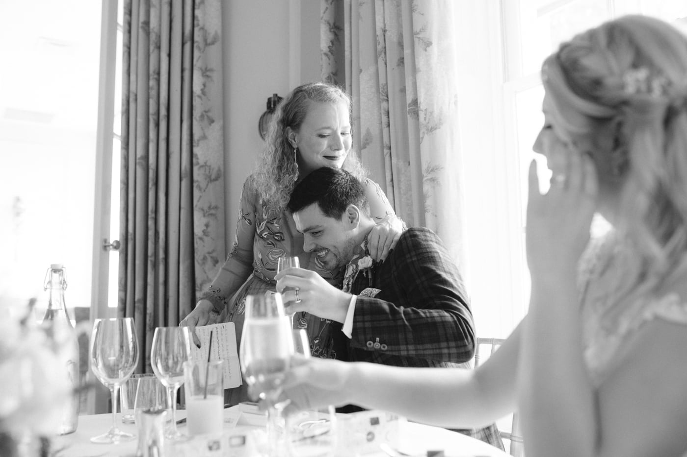 Guest and Groom Hugging, Table Speech at Storrs Hall Wedding