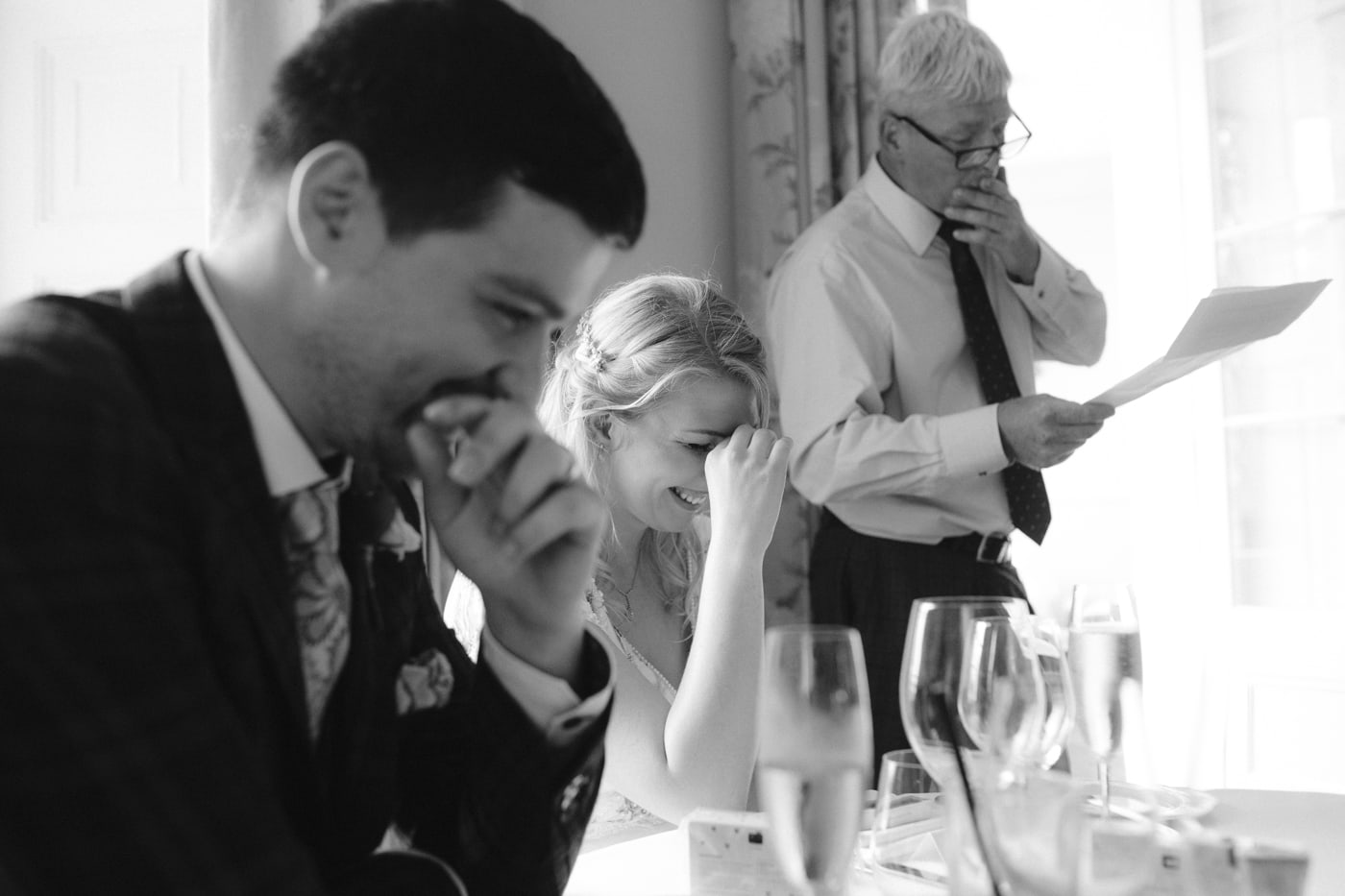 Bride and Groom Laughing at Wedding Speech at Storrs Hall Wedding
