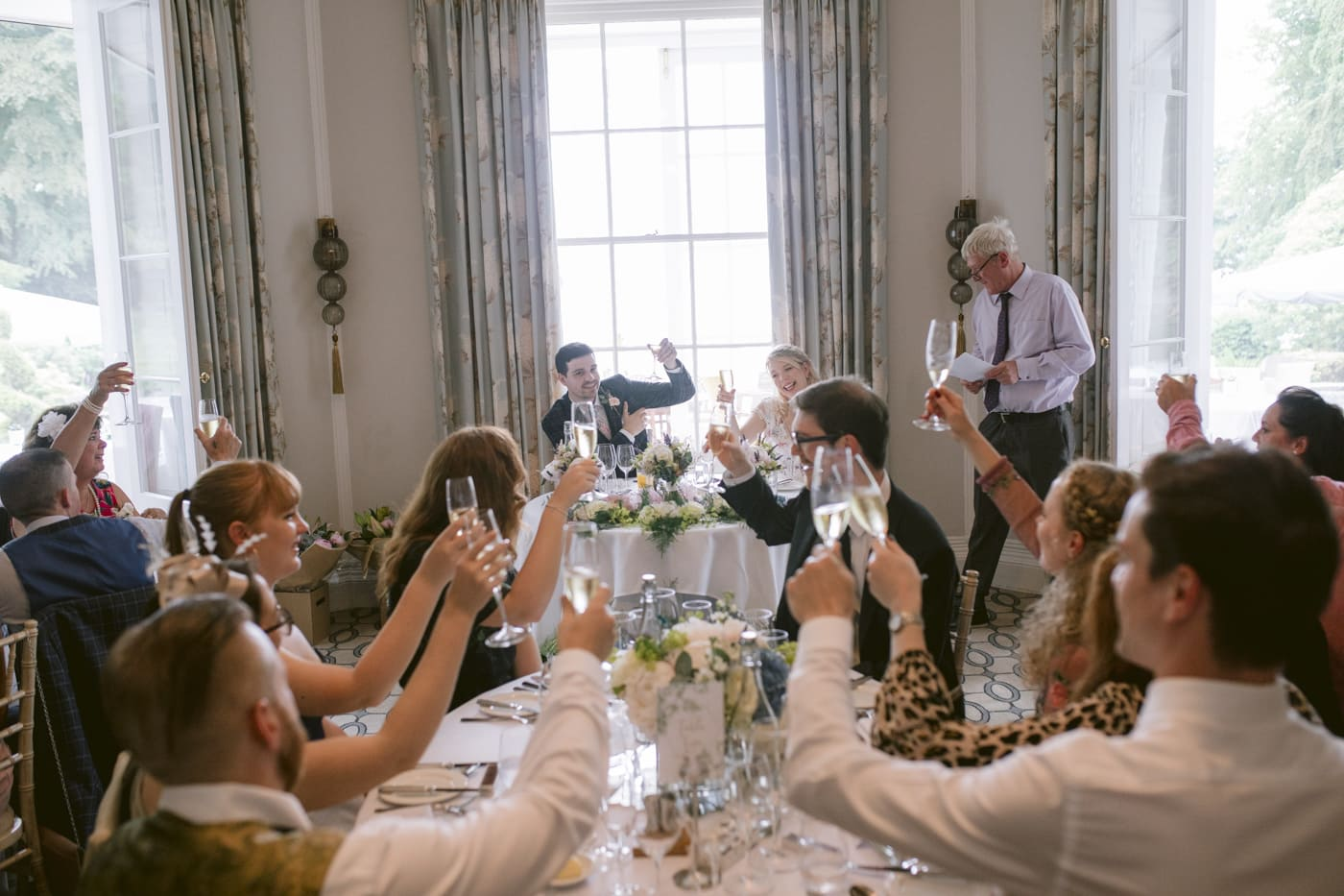 Guests and Bride and Groom Cheers and Congratulations at Storrs Hall Wedding