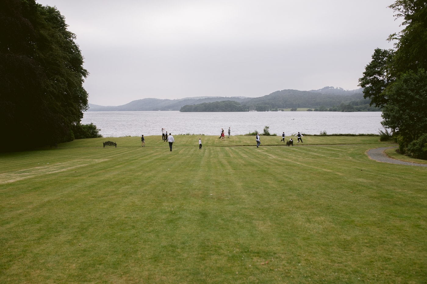Outside Distant Lakeside View with Guests at Storrs Hall Wedding