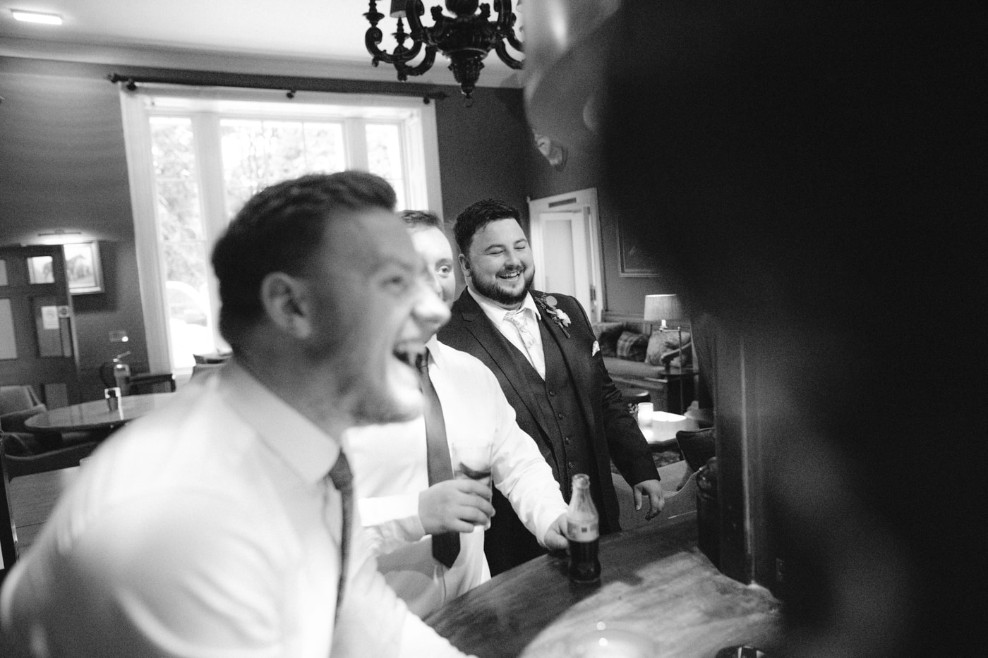 Guests Laughing in Hall at Storrs Hall Wedding