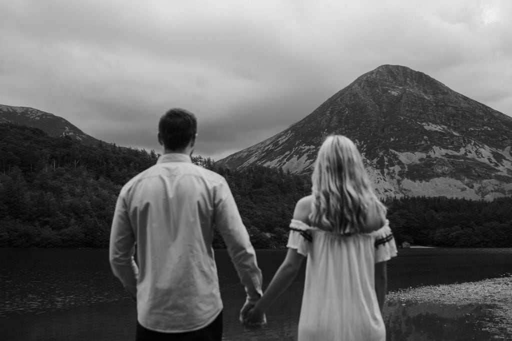 Couple walking hand in hand for a portrait session at Crummock Water