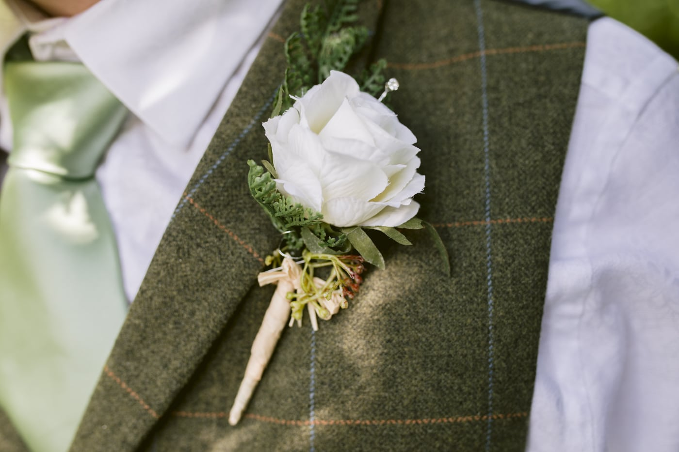 Groom Flower Pin Portrait at Roundthorn Country House