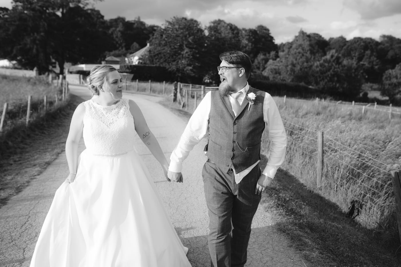 Bride and Groom Together Walking at Rounthorn Country House