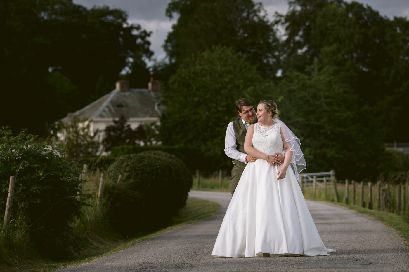 Bride and Groom Embraced Together at Roundthorn Country House