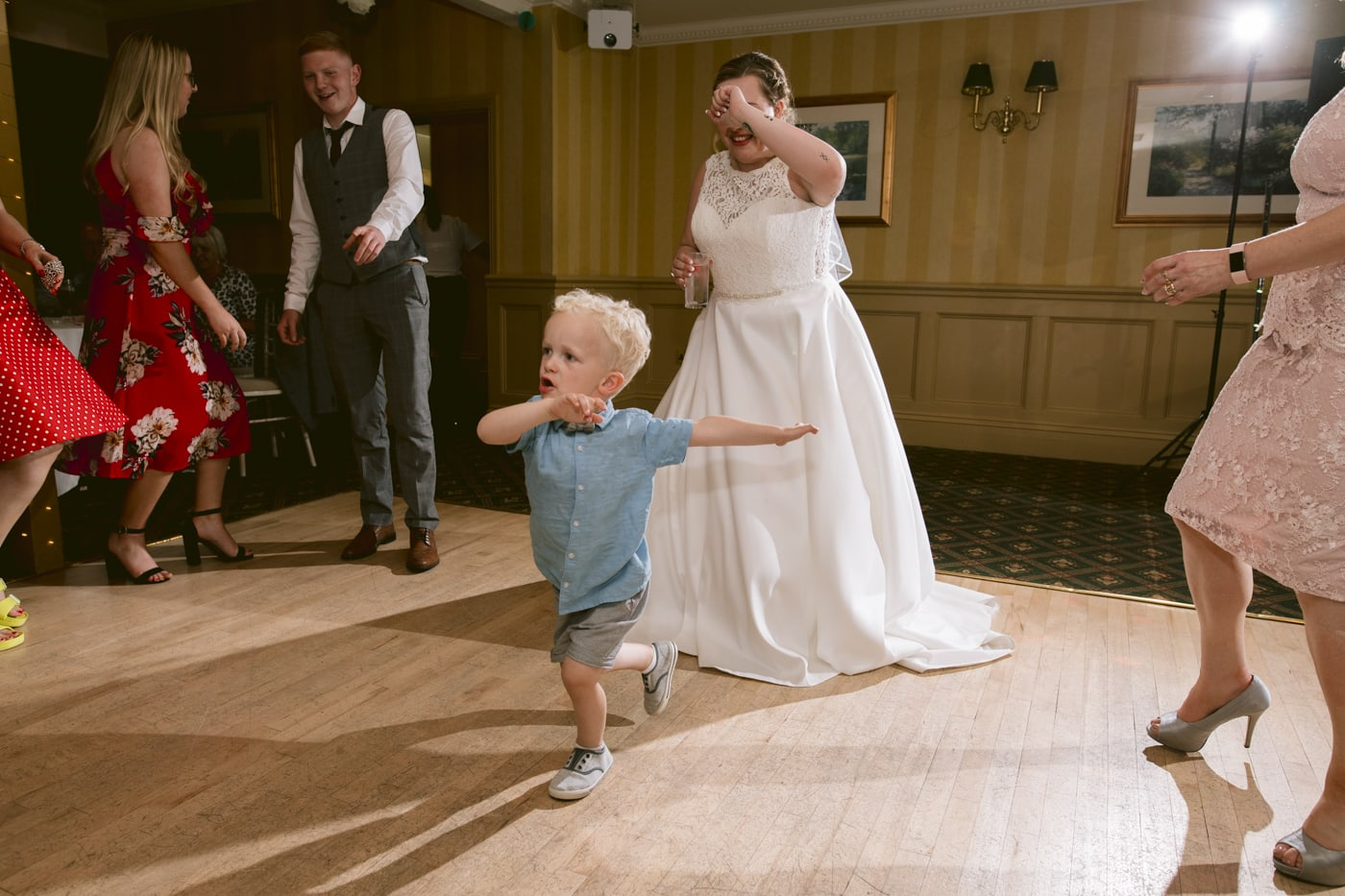 Bride and Child together Dancing at Roundthorn Country House