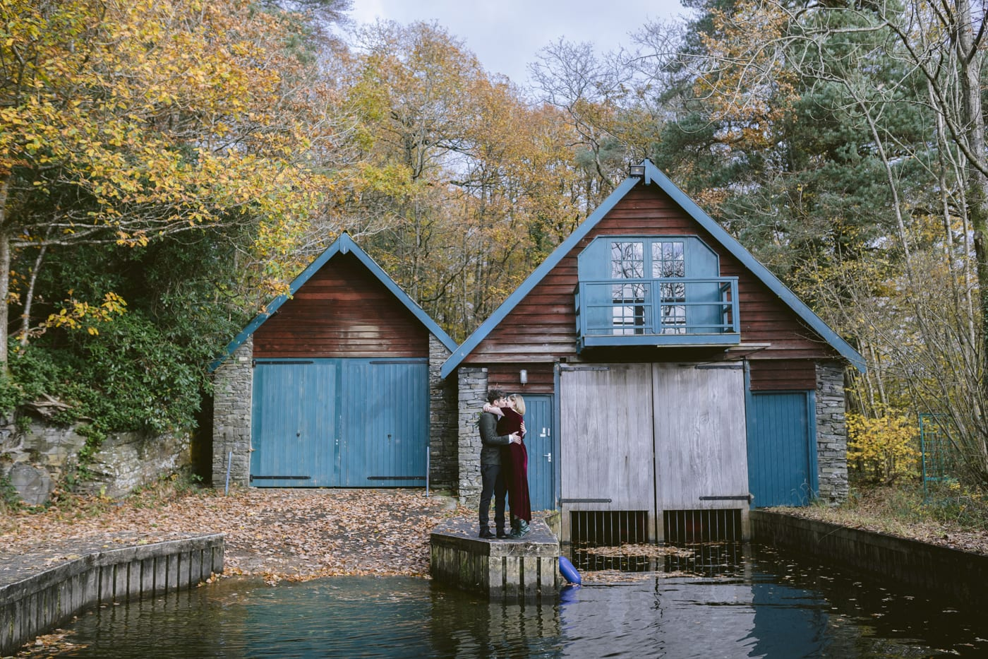 Couple stood on Boat house pier in the lake district as they elope at cragwood country house hotel