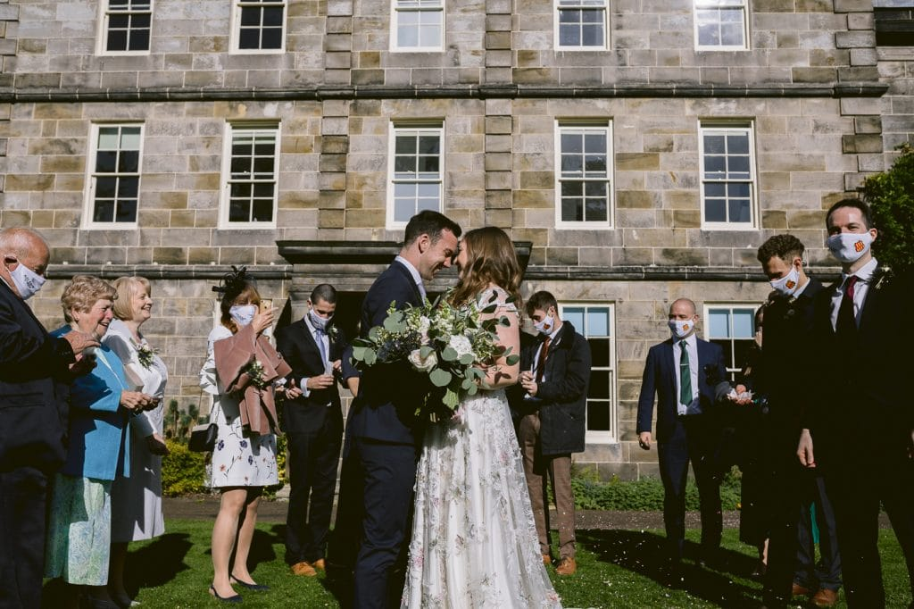 confetti throw over bride and groom at Hexham House